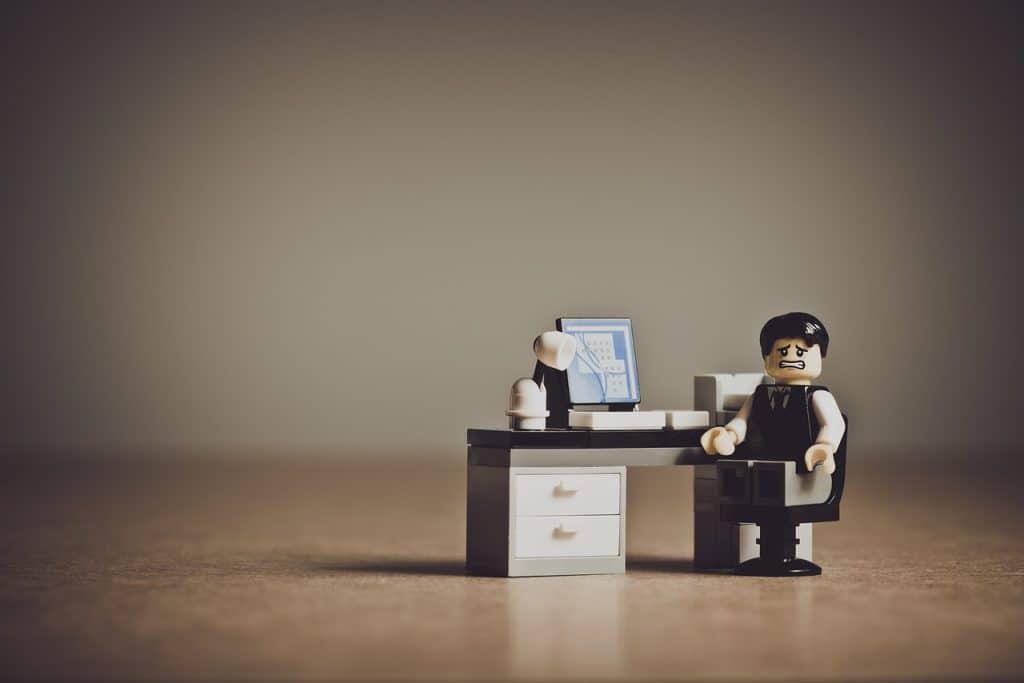 LEGO man sitting at work desk