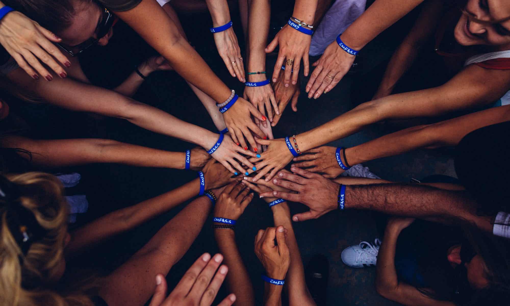 Hands together in huddle