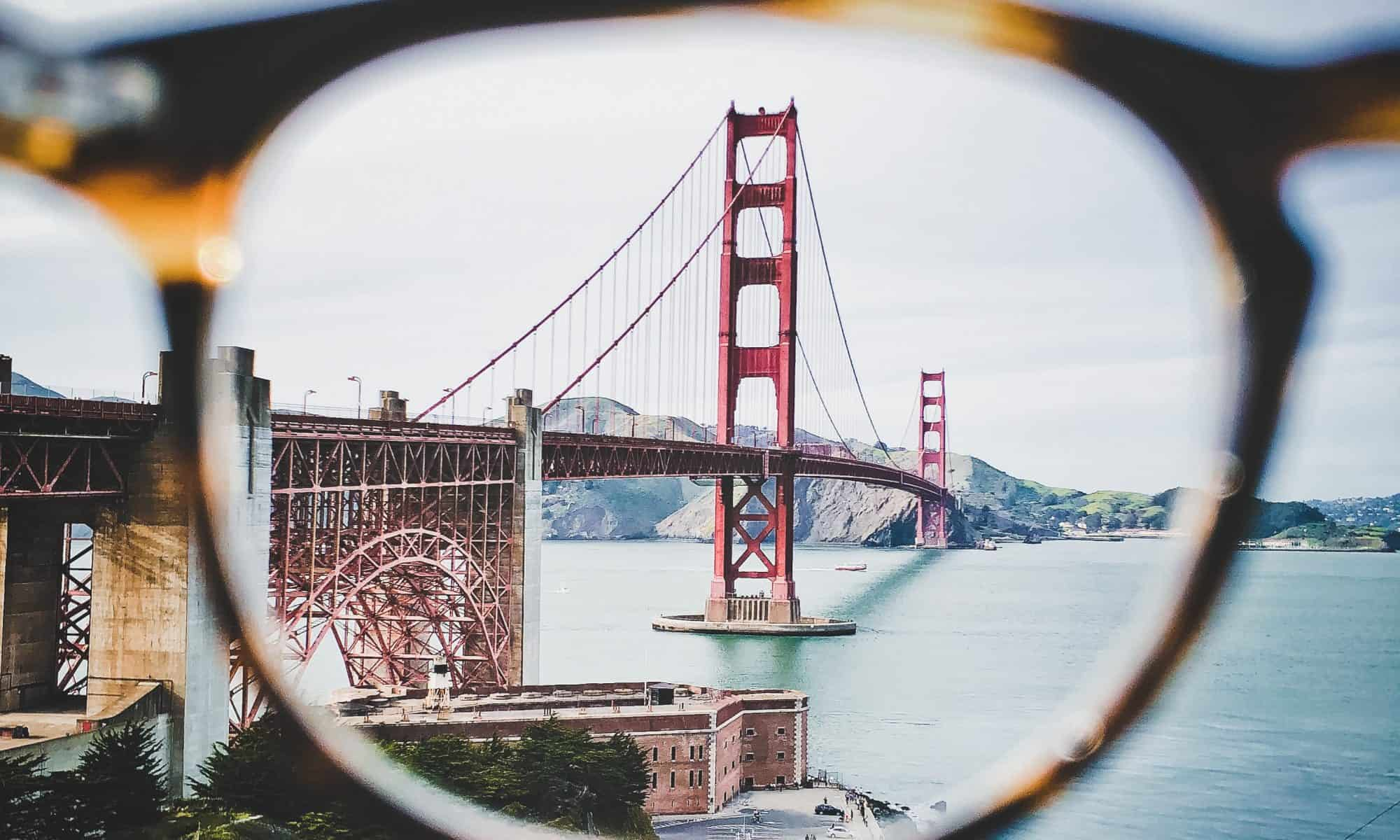 photo of a bridge through the lens of a pair of glasses