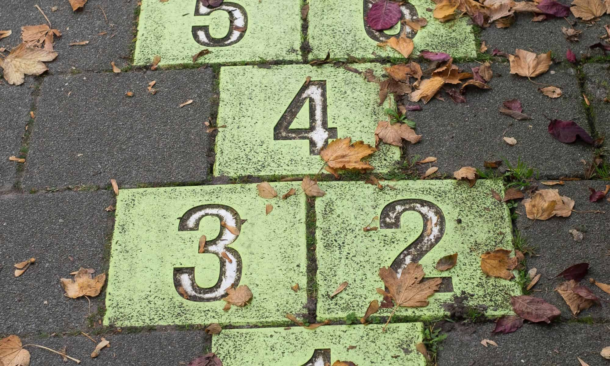 Numbers on ground in the hopscotch form